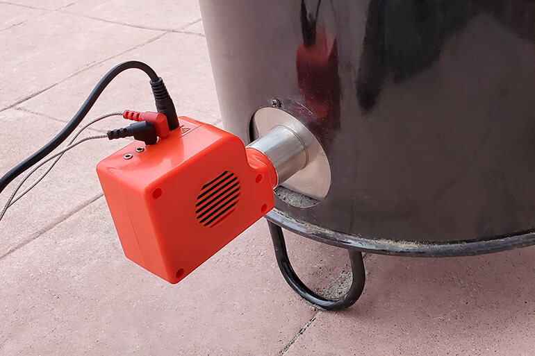 Smartfire controller attached to Pit Barrel Cooker