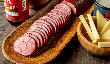 Planning an epic dinner party? This recipe for Smoked Venison Summer Sausage is just what you need to spice up that charcuterie platter.