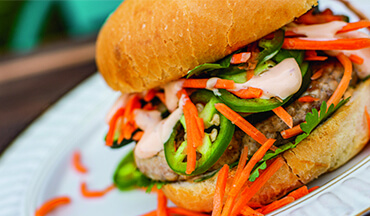 Break away from boring burgers with the bright and bold flavors of banh mi pheasant burgers.