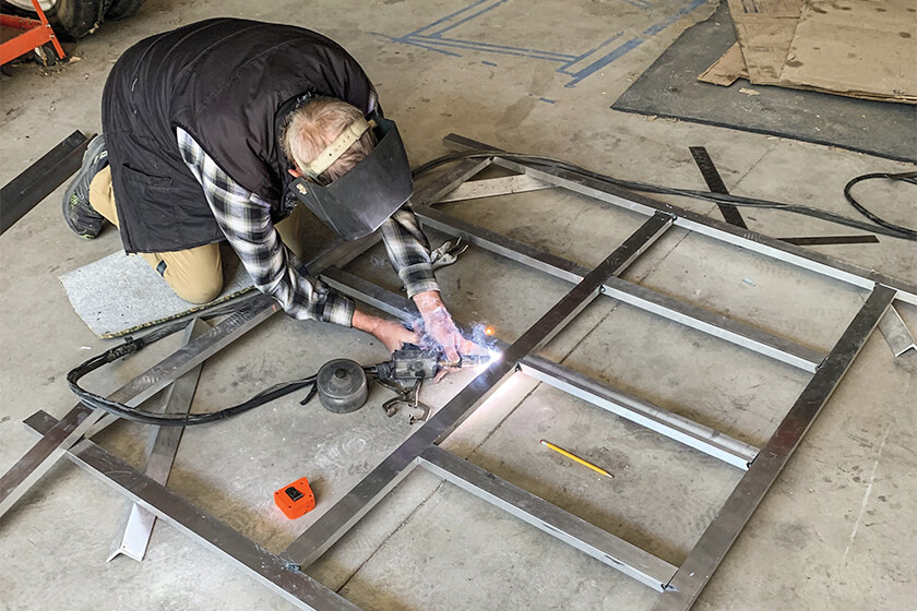 Welding a truck bed system
