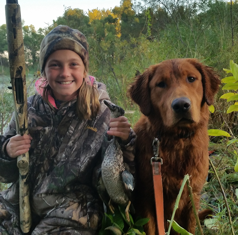 Kamryn with her first duck and dog Fawkes