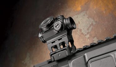 The Bushnell Lil P is a fancy little compact prism sight.