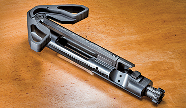 The Kali Key is a charging handle and special gas key that converts a semiautomatic AR into a bolt-action rifle, a creative solution to keep an AR compliant within California's laws.