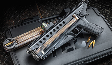 The KelTec P50 is a semiauto, but top ejecting with a top-break design.