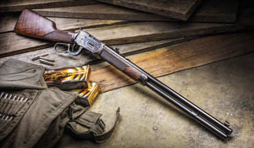 The sub-­7-­pound Winchester Model 1894 Deluxe Short Rifle has an overall length of 38-­inches and a length of pull that measures 13½ inches, making it suitable for self-defense or hunting purposes.