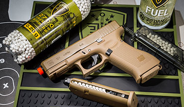 For self-defense training look at CO2 and green gas-powered guns like the Umarex Glock 19X. The gas-powered guns will offer blowback systems which makes the slide cycle and produces a strong recoil force.
