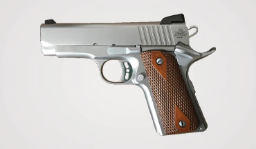 The Rock Island Armory EFS is a California compliant stainless steel 1911 with double diamond checkered wood grips and a snag free dovetail ramp.