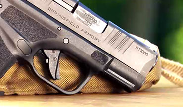 At the back of the Springfield Hellcat 9mm subcompact pistol's grip, the beavertail extends beyond the rear of the slide and encourages a high grip that works in conjunction with the high triggerguard cut above the frontstrap.