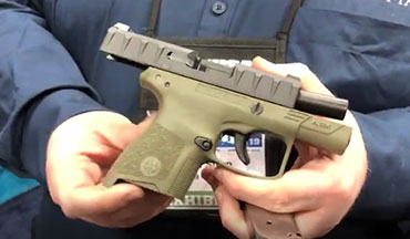 OSG's Lynn Burkhead talks with Erik Stern of Beretta about the new Beretta APX Carry pistol at the 2019 NRA Annual Meetings.
