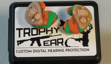 The Trophy Ear Flexx Pros are custom-fit electronic plugs with independent volume controls. The plugs ship with a DIY impression kit.
