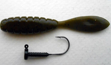 The Lunker City Ned Head Jig is best described as a wide flat bodied Beaver style grub measuring 3.5