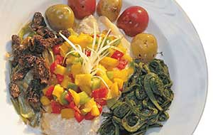 The fresh mango salsa is a great accompaniment to the creamy baked walleye.