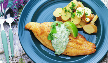 Top these cajun-rubbed catfish fillets with lime-cilantro sour cream and serve with a side of oven-roasted potatoes.