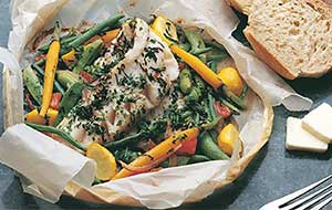 Cooking walleye en papillote helps to seal in the flavor of this tasty fish.