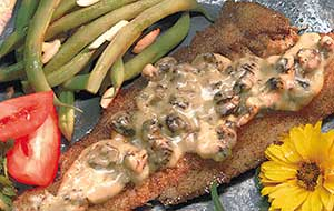 The morel mushroom sauce is a tasty addition to this wild rice-crusted walleye recipe.