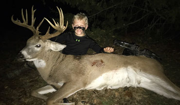 Only a week after his 9th birthday, a young Kansas hunter shares the deer hunting moment of a lifetime with his supervising father looking on.