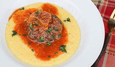 For an unforgettable meal everyone will love, make this osso buco recipe featuring cross-cut, bone-in slices of venison that are slowly braised with white wine, meat broth, aromatic vegetables and herbs