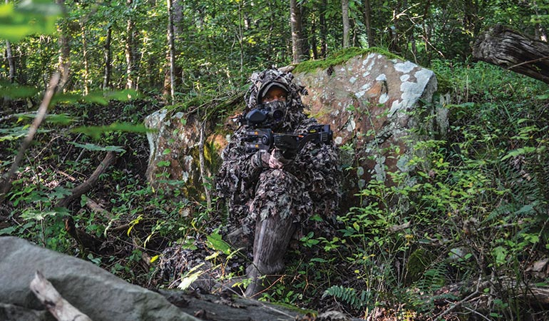 crossbow hunter sitting on ground