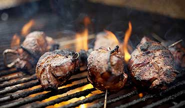 Take the best part of a deer and the best part of a pig and what do you get? Grilled venison backstrap, twice-marinated and wrapped in bacon.