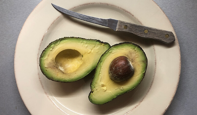 halved avocado plate