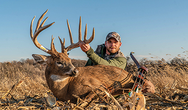 A hunter bags a monster on his new farm with traditional archery equipment.