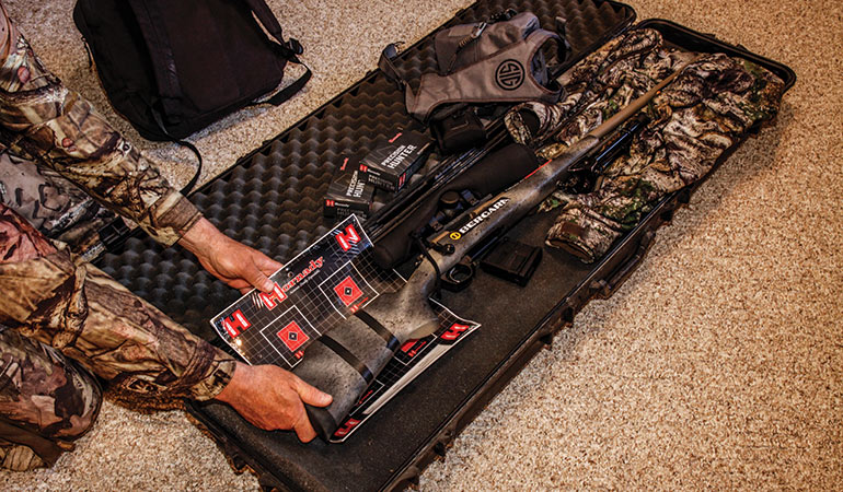 hunter packing deer rifle case