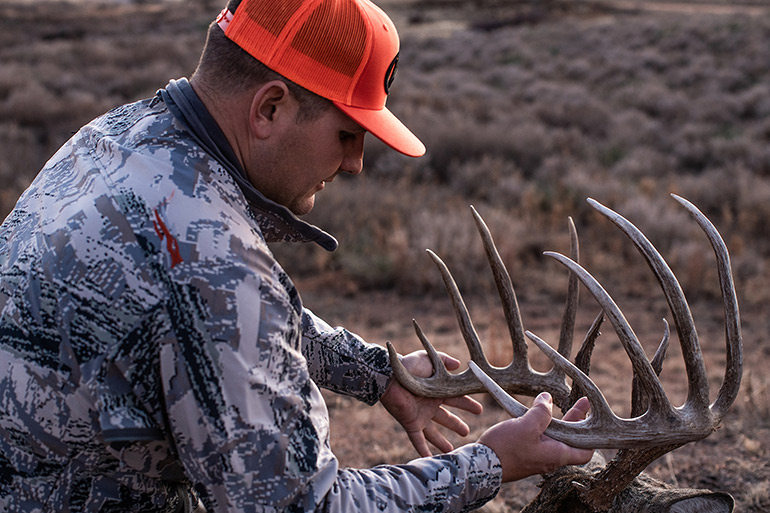 Troy Bryant with buck