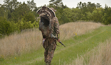 Take advantage of spring gobbler season to locate big bucks for the fall.