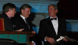 Beretta presented President George W. Bush with a custom-made SO10 EELL Shotgun before a crowd of nearly 3,000 at the final dinner for the 38th annual Safari Club International Convention in Reno, Nevada.