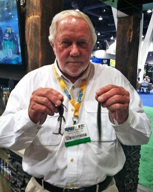 Guido Hibdon shows some soft plastics during ICAST. (Bassmaster.com photo)