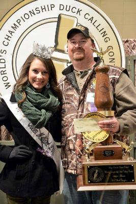 Allen holds his third trophy as he poses with Queen Mallard Hannah Oliver. (Courtesy Stuttgart Chamber of the Commerce)