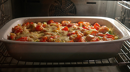 Layers of cheese, onion, tomato and delicious venison make this caribou hot dish the perfect family meal.