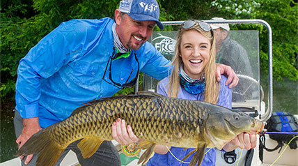 West Virginia Mountaineer college student Laken Fleming could find herself in the record books with a fly rod catch of a 14.25-pound common carp.