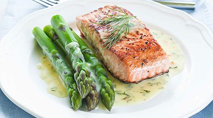 Turn your salmon catch into a delicious main course drizzled with hollandaise sauce and served with a side of asparagus.