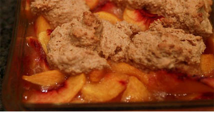 At the Oregon wilderness camp, much of the cooking is done in Dutch Ovens. Including desserts made by the camp member's mother, who usually comes for the opening weekend of deer camp. This Peach Cobbler is a favorite sweet for these hungry hunters.