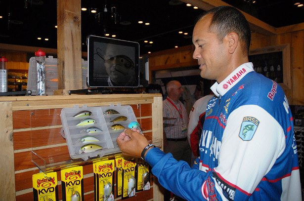 Strike King pro James Niggemeyer looks at the new KVD 8.0 squarebill crankbait that was introduced this week at ICAST 2014 in Orlando. (Photo credit Lynn Burkhead)