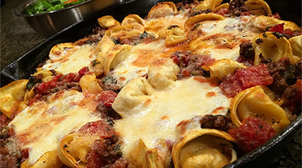 A flavorful wild game recipe that is easy to prepare and includes ground venison, cheese tortellini, petite diced tomatoes and three types of cheeses melted to a golden brown.