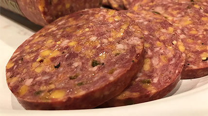 You'll love the sharp flavor of Cheddar cheese and spicy kick of jalapeño peppers in this venison summer sausage recipe.