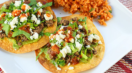 Crispy, warm tostadas topped with lean, ground venison, spices, fresh lettuce, onion, cilantro and guacamole.