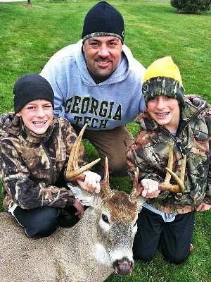 Mark Zona and his twin sons enjoy hunting together.