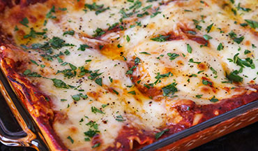 This tasty venison lasagna recipe is the perfect wild game meal to serve at a potluck or large family gathering.