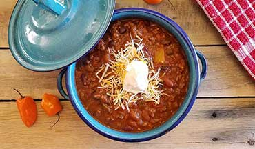 The sweet heat flavors of this Spicy Mango Venison Chili Recipe are downright delicious.