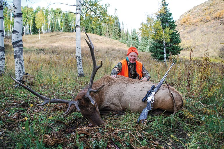 Craig Boddington with elk shot with lever action rifle