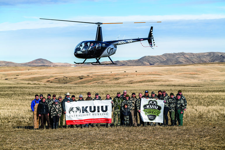 KUIU conservation group with helicopter