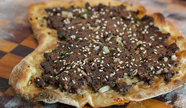 Meat pie or pizza – either way, this venison recipe is a fun one to try!