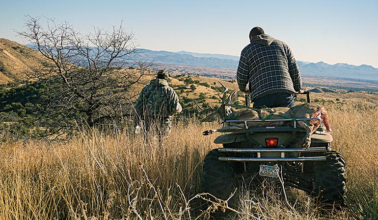 packing out Coues buck on atv
