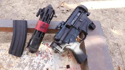 Patrick Sweeney of Firearms News shows off the Springfield Edge AR pistol with a folding arm brace.