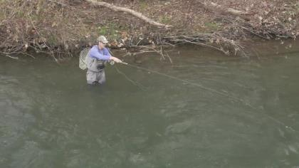 """George Daniels demonstrates the act of """"rod tapping"""" while Euro nymphing."""