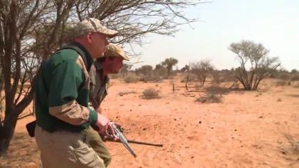 Smith & Wesson's Tony Miele and host Kevin Steele track an African lion across the Kalahari for the ultimate handgun showdown with the King of the Beasts.