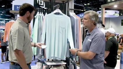 Huk's Wavepoint collection uses polyester fibers from 9 plastic bottles woven into each garment. With Huk's Prescott Hughes and In-Fisherman's Rob Neumann at ICAST 2021 in Orlando.